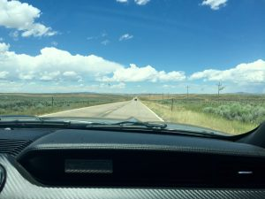 Cruising down a highway through Montana in a '15 Ford Mustang